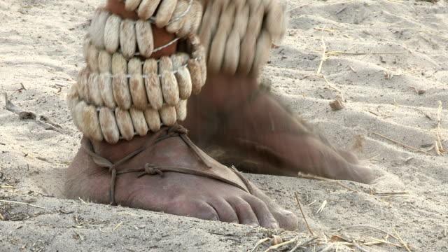 Close-up of Bushmen feet dancing rattles video
