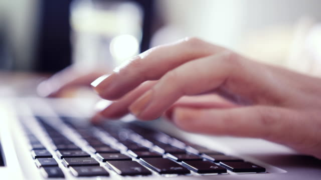 closeup of business woman hand typing on laptop keyboard - key stock videos & royalty-free footage