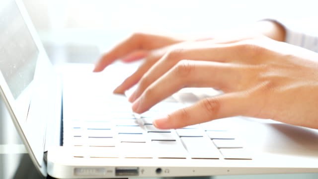 Closeup of business woman hand typing on laptop keyboard video