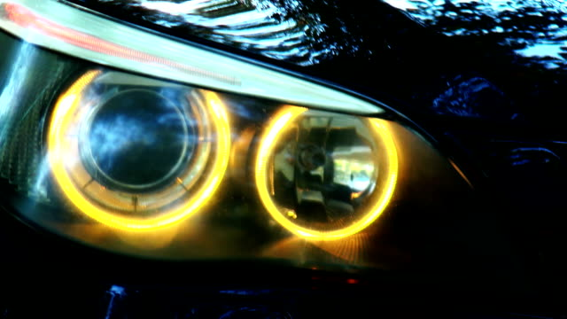 Close-up of car headlights Close-up of car headlights . Focus, Rasfokus luxury car stock videos & royalty-free footage