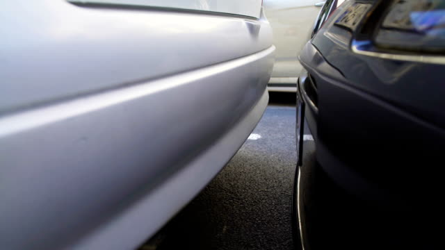 Close-up of car hitting another auto while parking, property damage, insurance video