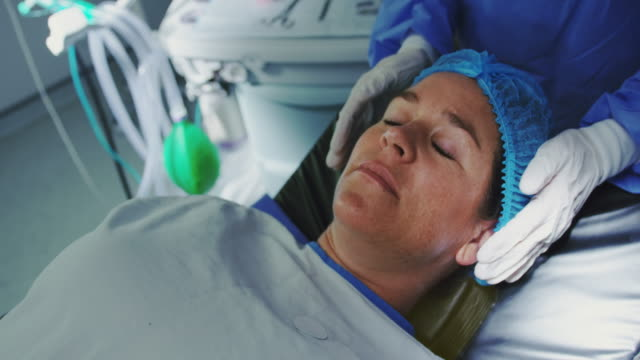 Close-up of Caucasian pregnant woman lying on surgical bed in operation theater 4k