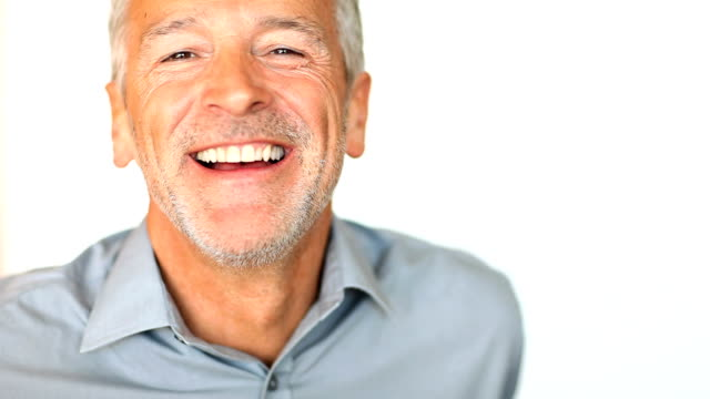Closeup of cheerful mature man laughing video