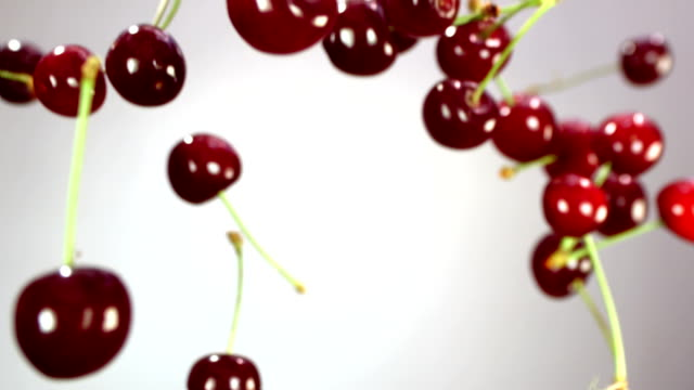 Close-up of cherry rotates in the air Close-up of cherry rotates in the air on a white background cherry stock videos & royalty-free footage