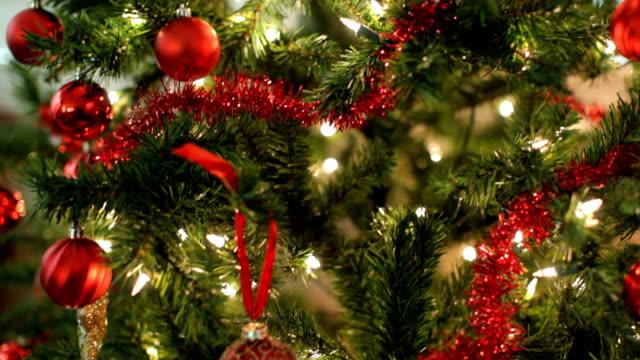 closeup of christmas tree, jib up - julgran bildbanksvideor och videomaterial från bakom kulisserna