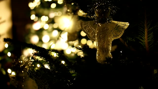 Close-up of christmas tree. Detail of christmas tree - ornaments, lights and needles. Shallow depth of field and blurred background. Camera moving left. focus on foreground stock videos & royalty-free footage