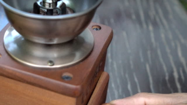 Close-up of coffee grinders,Slow motion video