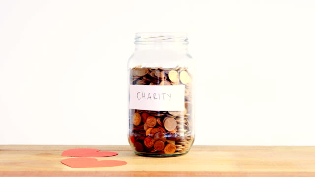 Close-up of coins in bottle and heart video