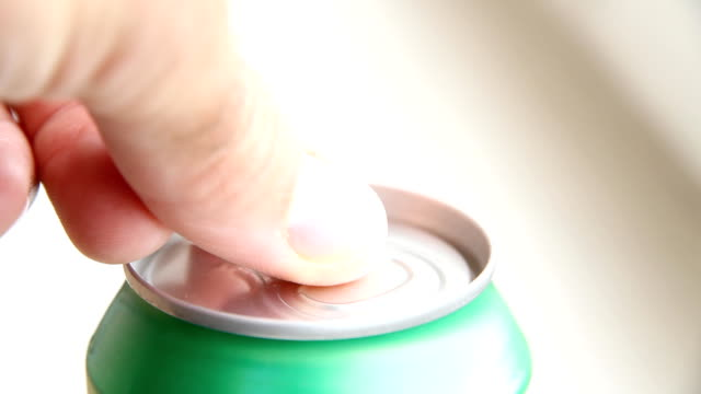 Closeup of cola can - Cream soda drink opening video