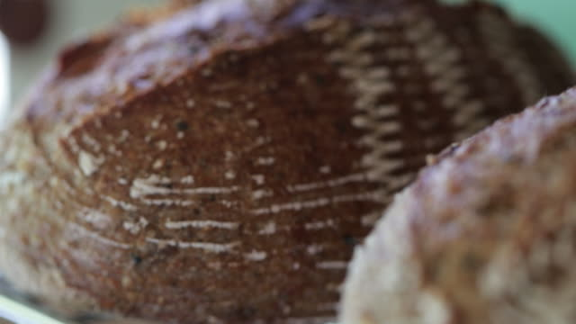 Close-up of crisp traditional bread Close-up of crisp traditional bread natural condition stock videos & royalty-free footage