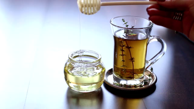 Closeup of cup of tea with honey video