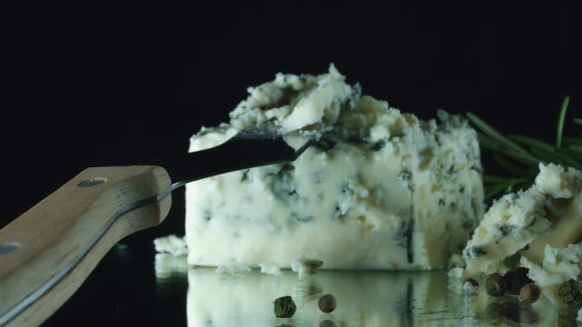 4K Close-up of Cut Blue Cheese with Herbs video