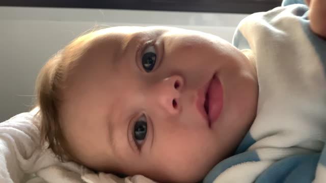 closeup of cute adorable baby infant blond boy - 0 11 mesi video stock e b–roll