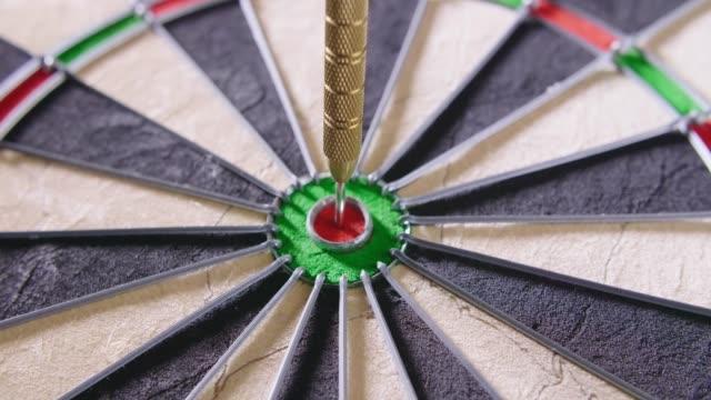 Closeup Of Dart Hitting Bullseye video