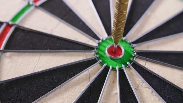 Closeup Of Dartboard With Darts Hitting Bullseye video