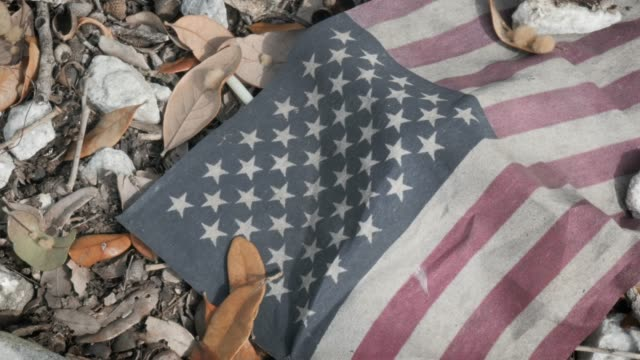 Closeup of Dirty United States Flag Symbolic of Failing American Values