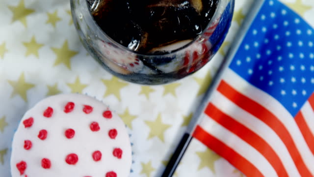 Close-up of drink and cupcake with 4th july theme video