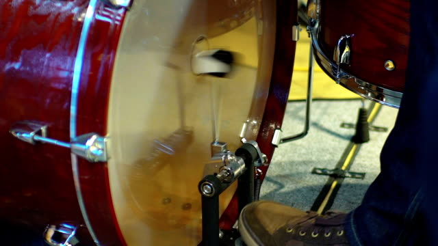 Closeup of drummer's foot moving drum bass pedal, slowmotion video