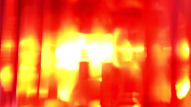 closeup of emergency response flashing siren beacon light spinning - настороженность стоковые видео и кадры b-roll
