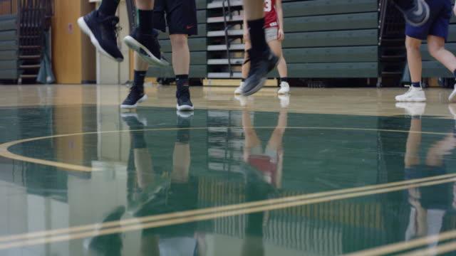 close-up of female basketball player's feet in the key - sprzęt sportowy filmów i materiałów b-roll