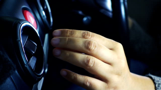 Close-up of female hand adjusting air vents to change wind on a vehicle's dashboard. video