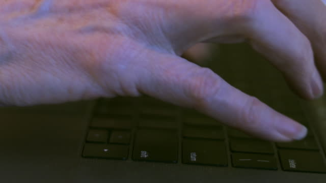 Close-up of Female Hands Typing Keyboarding on a Personal Laptop 4K Video