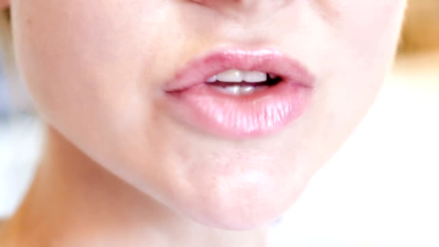 close-up of female lips - рот стоковые видео и кадры b-roll