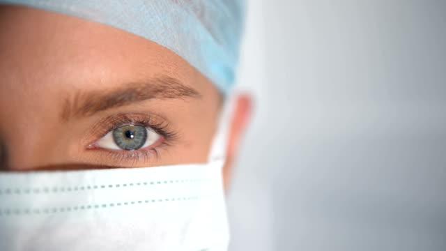 Close-up of female surgeon eye video