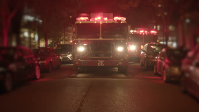 close-up of fire engine with warning lights. fire truck at night. - firefighter stock videos and b-roll footage