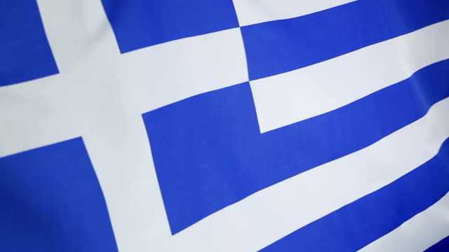 closeup of flag of greece in slow motion - grecia stato video stock e b–roll