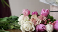 istock Close-up of florist gathering bouquet in flower shop 1212917217