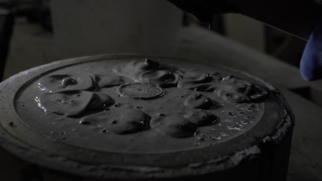 close-up of fresh concrete is added to a special mold for casting parts. wet concrete in silicone form. 4k. 4k video. slow motion. 23.98 fps