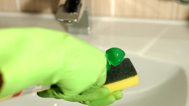 close-up of girl pouring the gel on the sponge. - bleach stock videos & royalty-free footage
