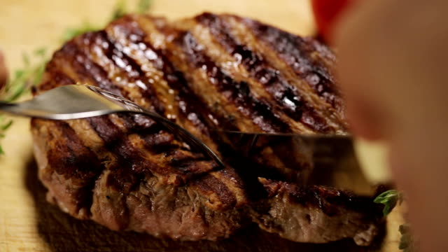 Closeup of grilled steak on the cutting board video