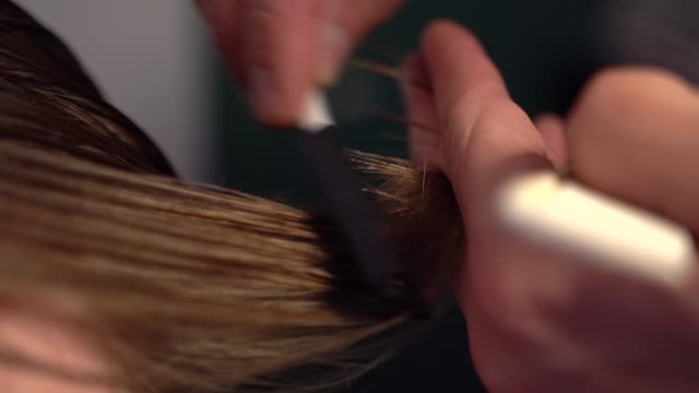 Close-up of haircut master cutting with scissors video