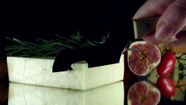 4K Close-up of Hand Cutting White Cheddar Cheese video