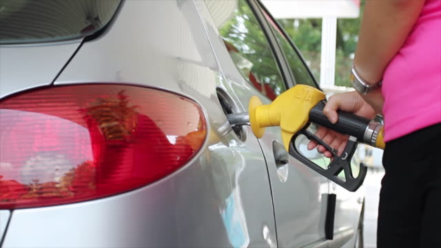 Closeup of hand refilling the car with fuel. video