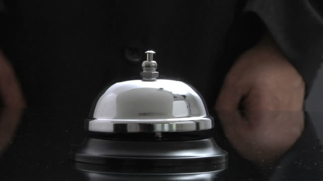 Closeup of hand ringing service bell video