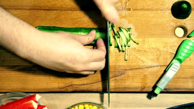 Closeup of hands chop the cucumber. video