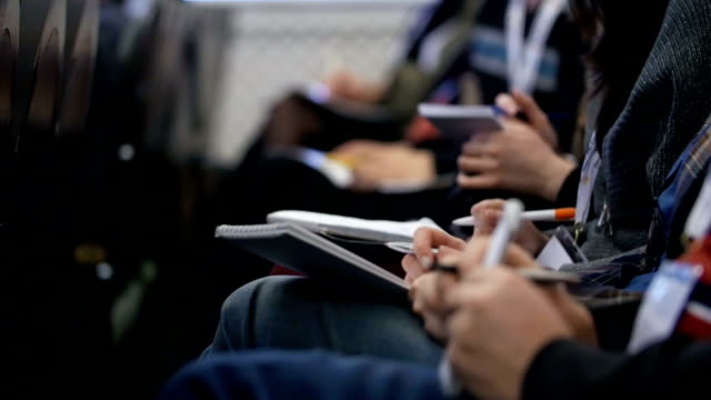 close-up of hands holding pens and making notes - abbigliamento formale video stock e b–roll