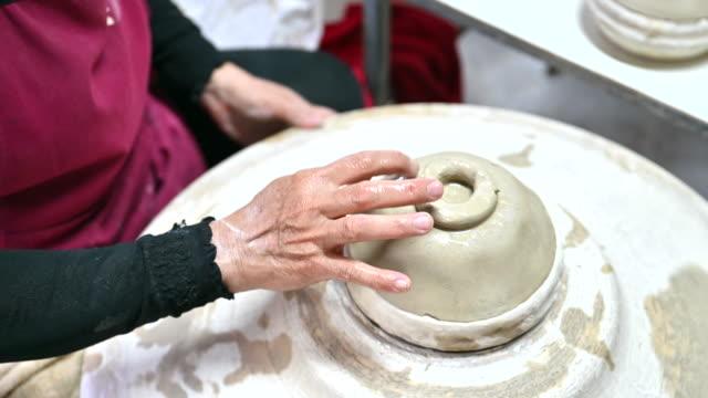 Closeup of Hands shot Skillful Potter Working, Pottery handmade