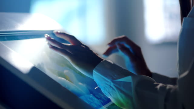 vídeos de stock e filmes b-roll de close-up of hands touching modern screen in the hi-tech office or software lab - new