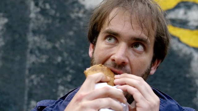 Close-up of happy Man Eating kebab wrap video