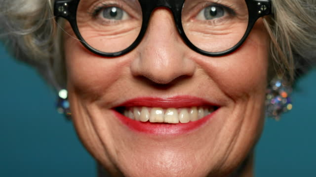 close-up of happy mature woman's face - testa video stock e b–roll