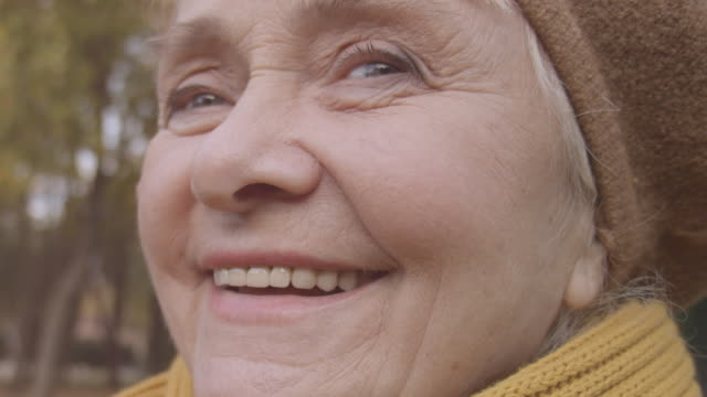 Close-up of happy old lady woman smiling with healthy teeth, elderly dental care