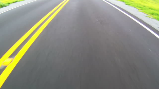 Close-up of highway while moving along the yellow line video