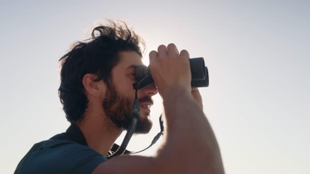 Closeup Of Hiker Looking Through Binoculars video