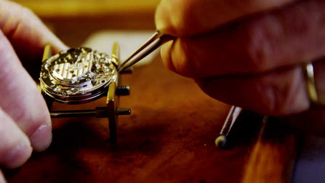 Close-up of horologist hands repairing a watch video