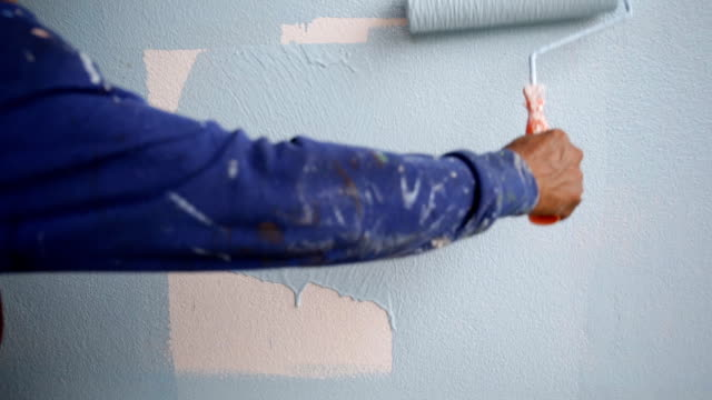 Closeup of human painting with blue paint video