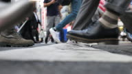 istock Close-up of Leg People walking on the crosswalk 1281926679